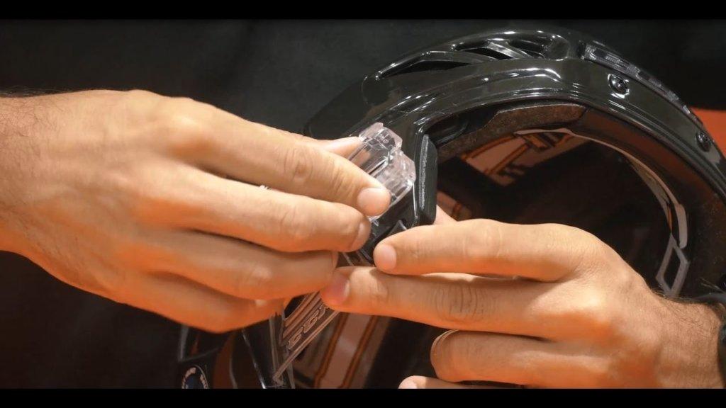 Fitting visor to helmet