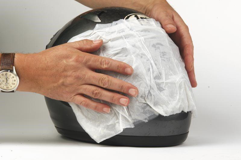 Cleaning motorcycle helmet visor
