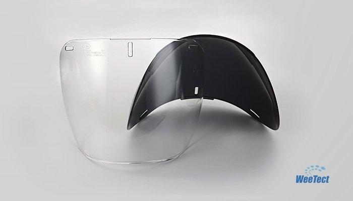 Tinted helmet visors